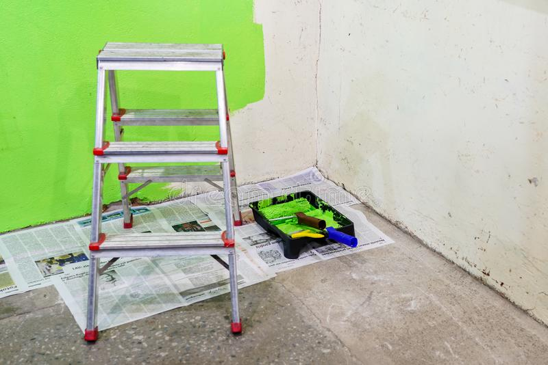 Room repairs in the house, wall painting with green color stock images