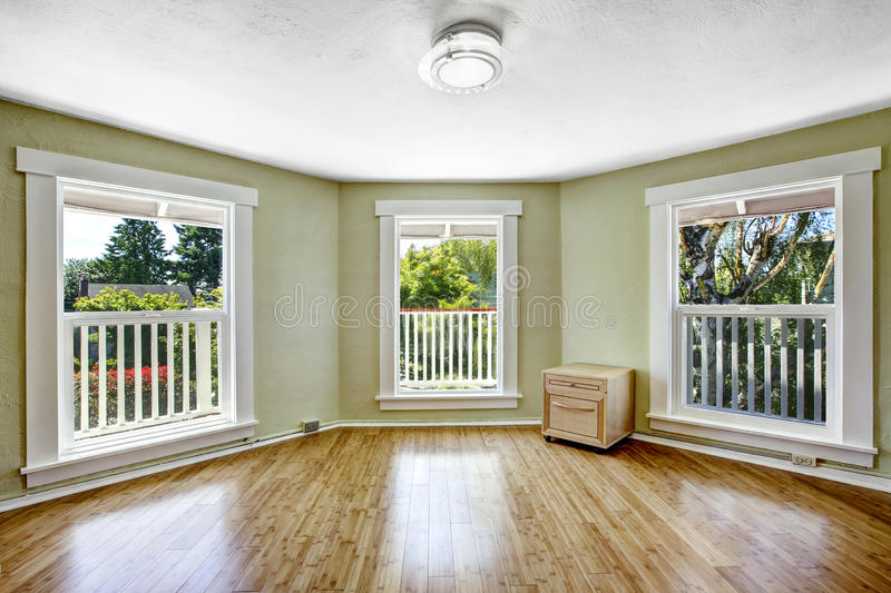 Room with tree windows in empty house royalty free stock images