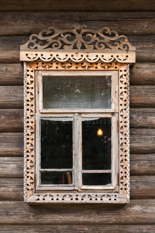 Russian window in carved wooden frame royalty free stock photo