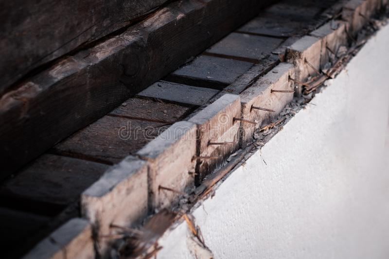 Rusty nails in old wooden wall, construction concept.  stock photography