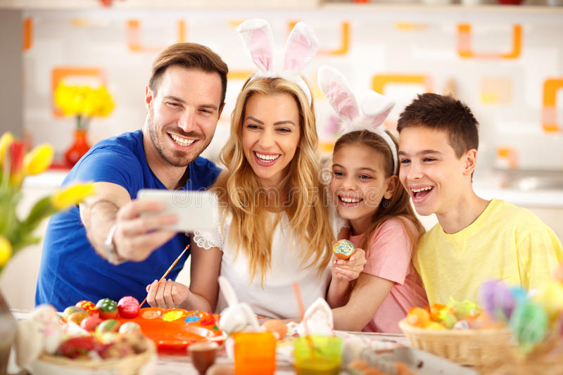 Selfie in kitchen while painting Easter eggs. Family selfie in kitchen while painting Easter eggs stock photos