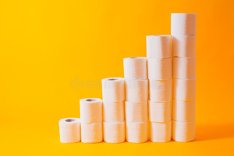 Shedule toilet paper rolls isolated on yellow. Background royalty free stock image