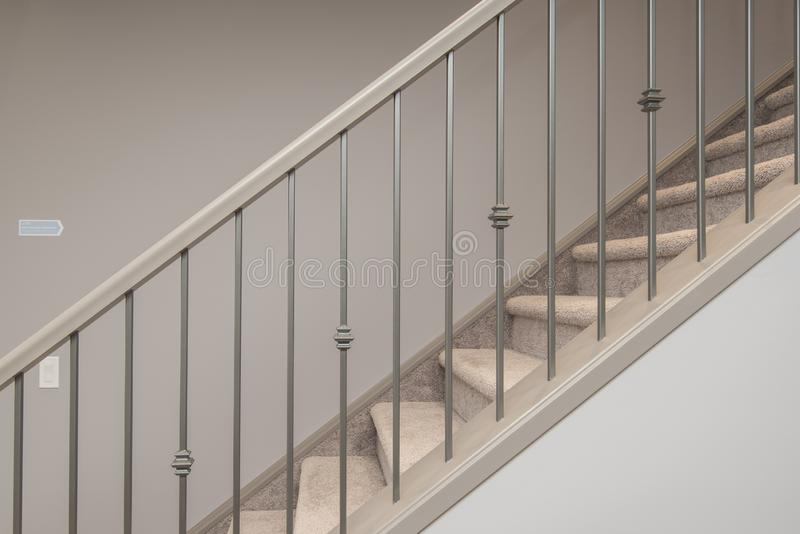 Shot of stairs inside of house with silver handrail. A shot of stairs inside of house with silver handrail royalty free stock images