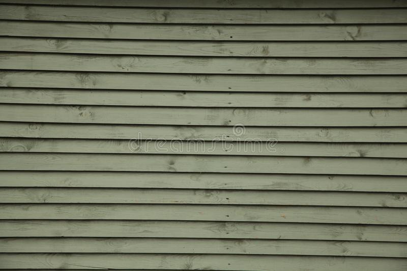 Siding of blinds wooden louvers background stock photos