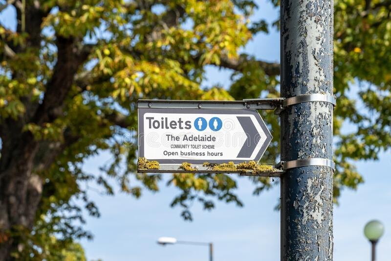 A sign giving directions to a member of community toilet scheme in teddington, london, England royalty free stock images