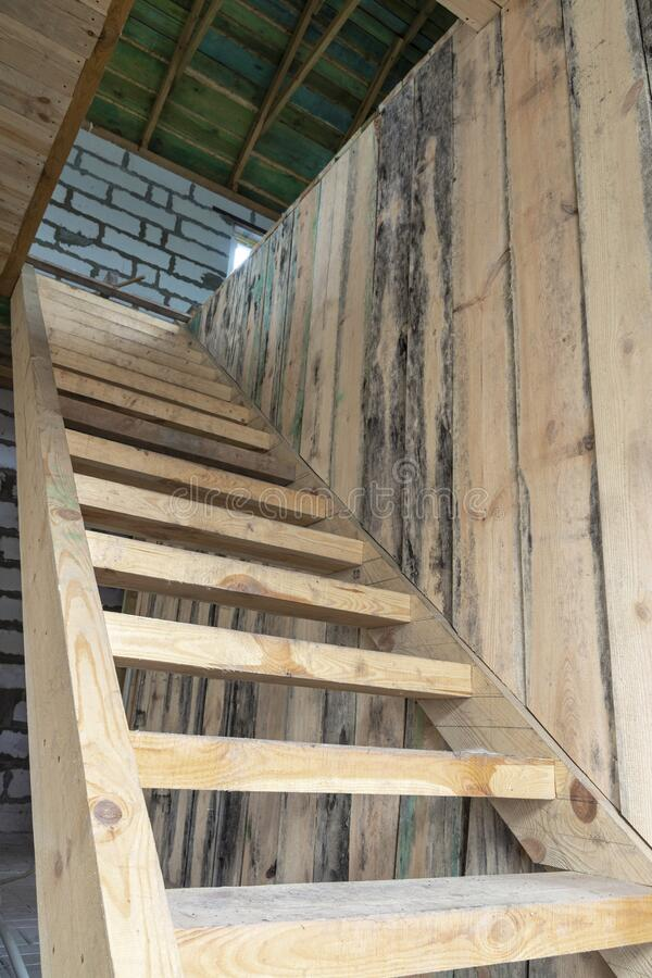 Simple cheap wooden staircase to the second floor stock image