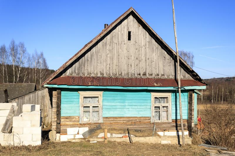 Small old wooden construction. shot on a bright sunny day. the house needs repairs. Text toning stock images