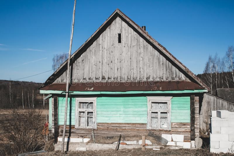 Small old wooden construction. shot on a bright sunny day. the house needs repairs. Text toning royalty free stock image