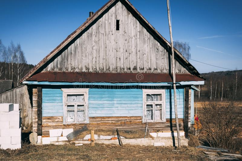 Small old wooden construction. shot on a bright sunny day. the house needs repairs. Text toning stock image