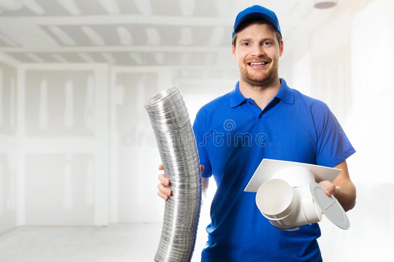 Hvac technician ready to install ventilation system in house stock images