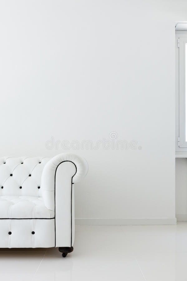 Sofa in white room stock photos