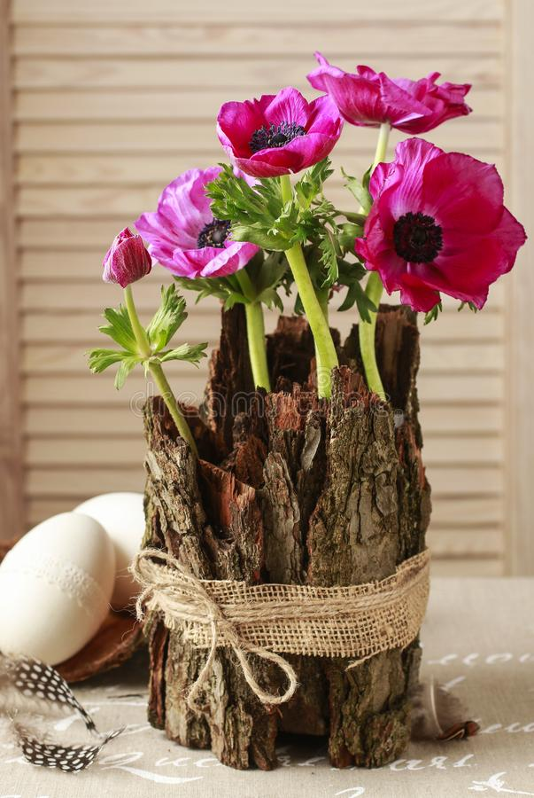 Spring table decoration with bark and anemone flowers. Party decor stock images