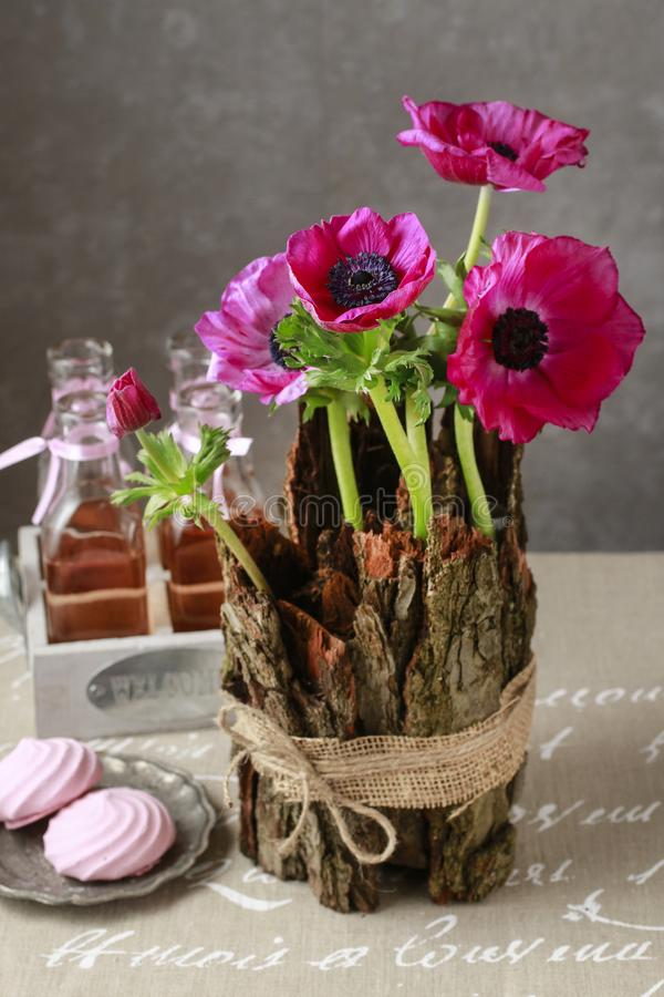 Spring table decoration with bark and anemone flowers. Party decor royalty free stock images