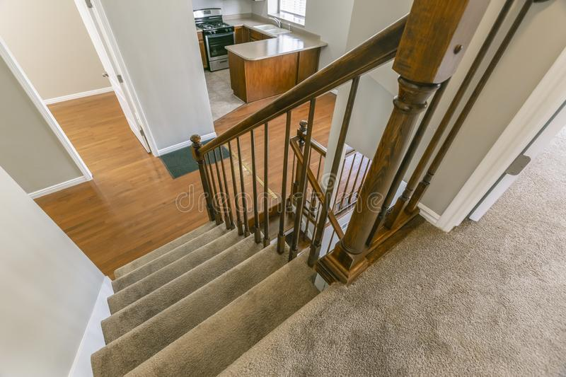 Staircase inside a house overlooking the kitchen and an empty room stock photos