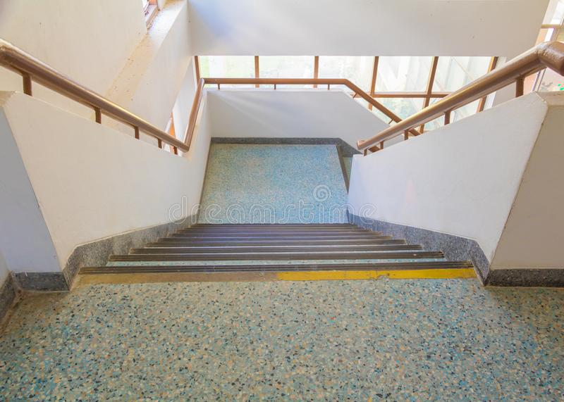 Stairs blue old terrazzo floor walkway down Inside the building. select focus with shallow depth of field.  royalty free stock photos
