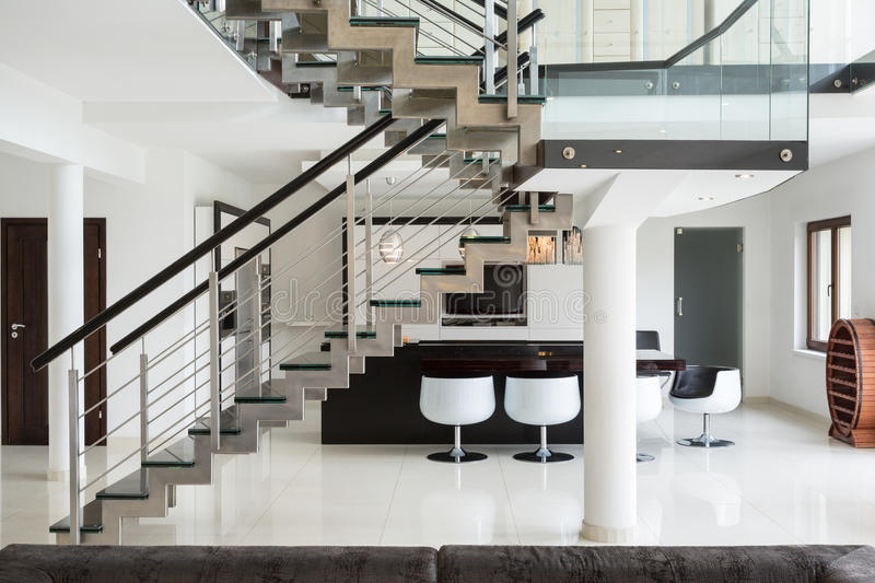 Stairs on the first floor. White marble stairs on the first floor in luxury apartment royalty free stock photos
