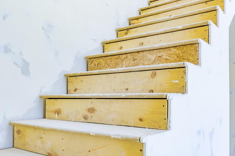 Stairs inside of house under construction in Utah. Stairs inside of house under construction with wood exposed. Utah valley new homes royalty free stock image