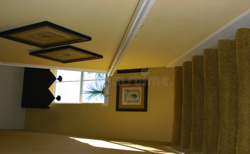 Stairs to second floor of modern upscale home. Painted yellow stock images