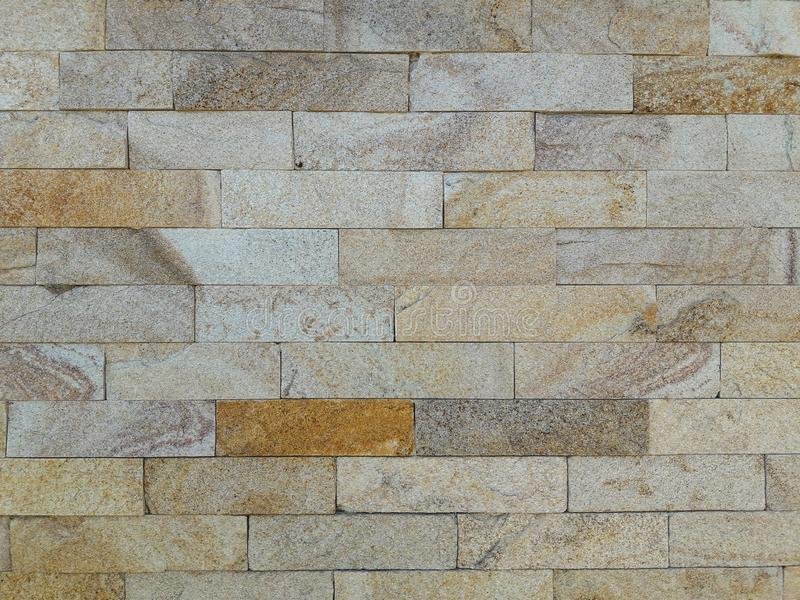 Stone texture. Finishing the facade of the house.Gray, brown and yellow color background. Stone textures. Finishing the facade of the house.Gray, brown and stock photos