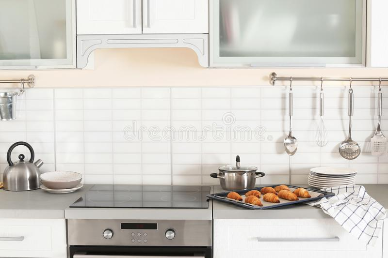 Stylish kitchen interior with oven and set of cooking utensils. Stylish kitchen interior with modern oven and set of cooking utensils stock photo