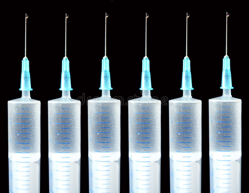 Syringes. On black background - collage royalty free stock photography
