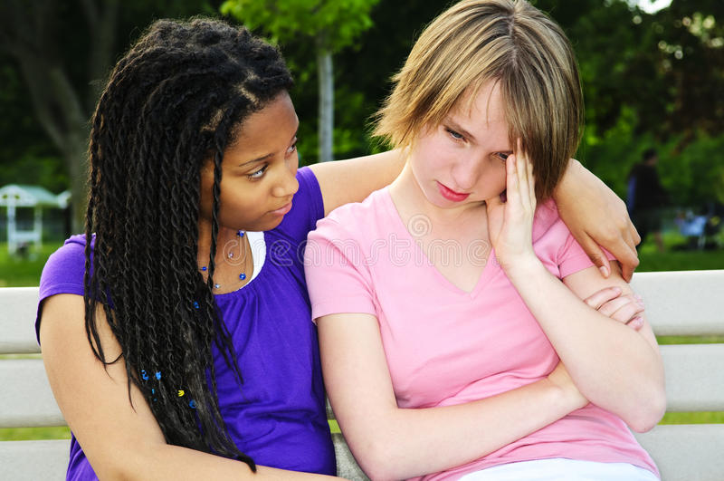 Teenager consoling her friend stock photography