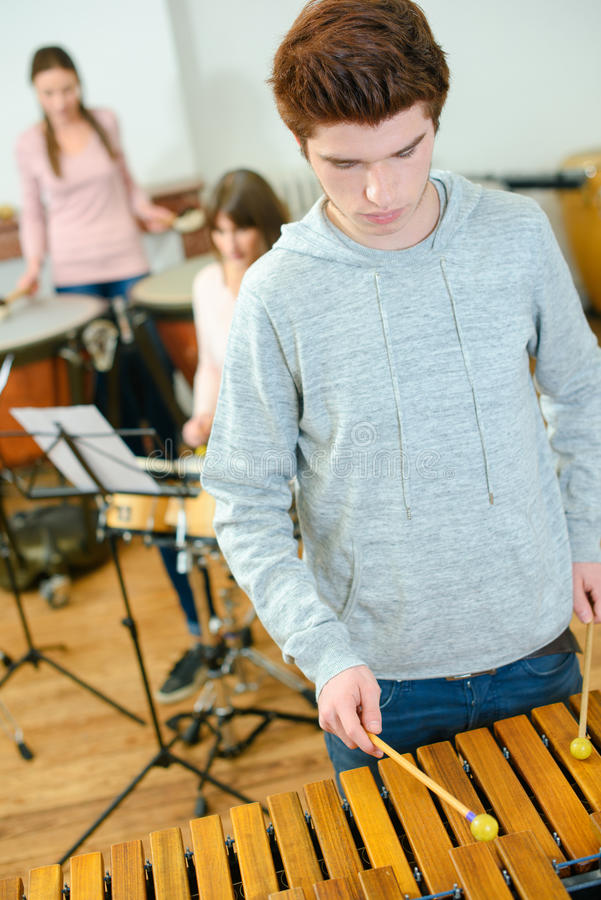 Teenager learning to plat xylophone royalty free stock photography