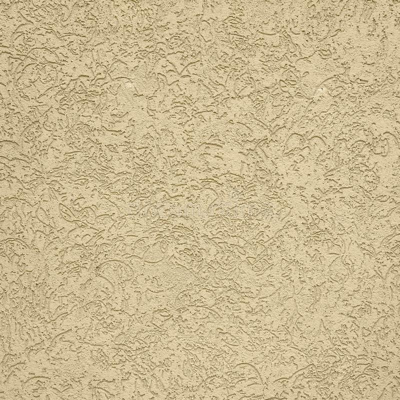 The texture of the beige decorative plaster in bark beetle style. Russian variation of decorating facade walls royalty free stock photos