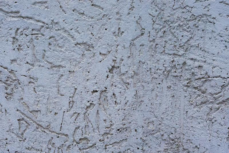 Texture of the decorative stucco wall as a background. Bark beetle style stock photography