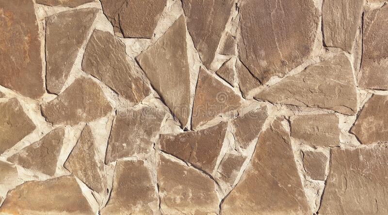 The texture of the finishing stone on the wall. stock photos