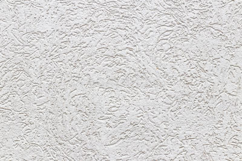 Texture of a fragment of a wall of a modern structure of white color. Harshness in the style of bark beetle.A background for desig. N and creative work stock photos