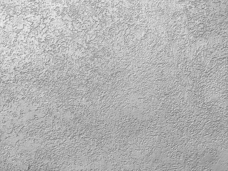 Texture of the grey plaster bark beetle on the wall. Seamless texture. The texture of the plaster is bark beetle on the wall. Seamless grey texture royalty free stock images