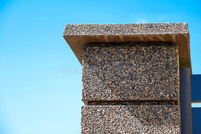 The texture of the stone fence with rectangular blocks, granite chips. royalty free stock image