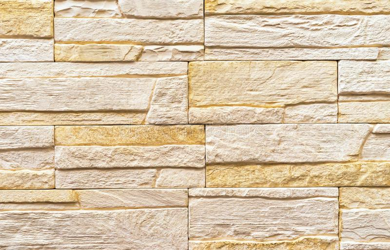 Texture of the stone wall. Panel of stones for finishing the facade of the building and interior design of the house.  royalty free stock photos