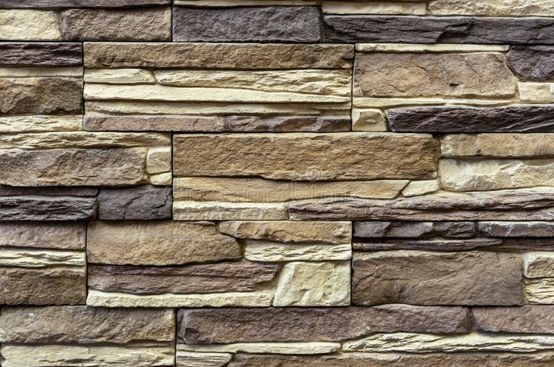 Texture of the stone wall. Panel of stones for finishing the facade of the building and interior design of the house. Background. For design and decoration stock photography