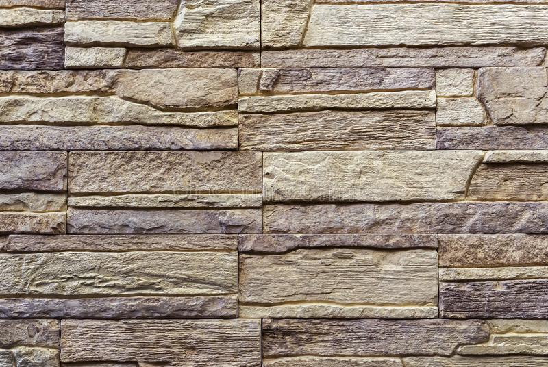 Texture of the stone wall. Panel of stones for finishing the facade of the building and interior design of the house. Background. For design and decoration royalty free stock photos