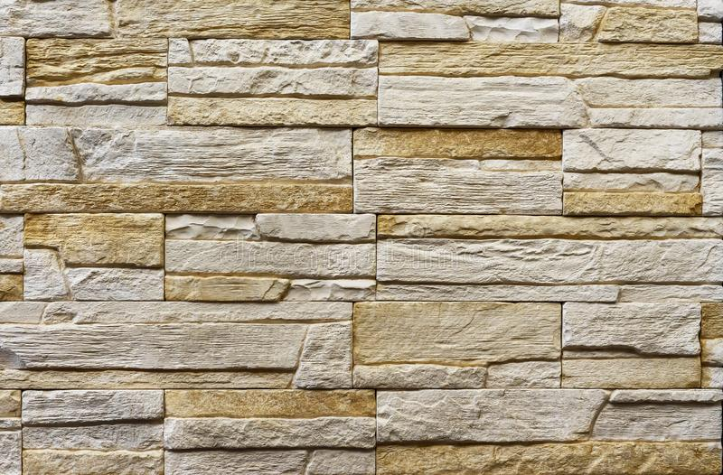 Texture of the stone wall. Panel of stones for finishing the facade of the building and interior design of the house. Background. For design and decoration stock image