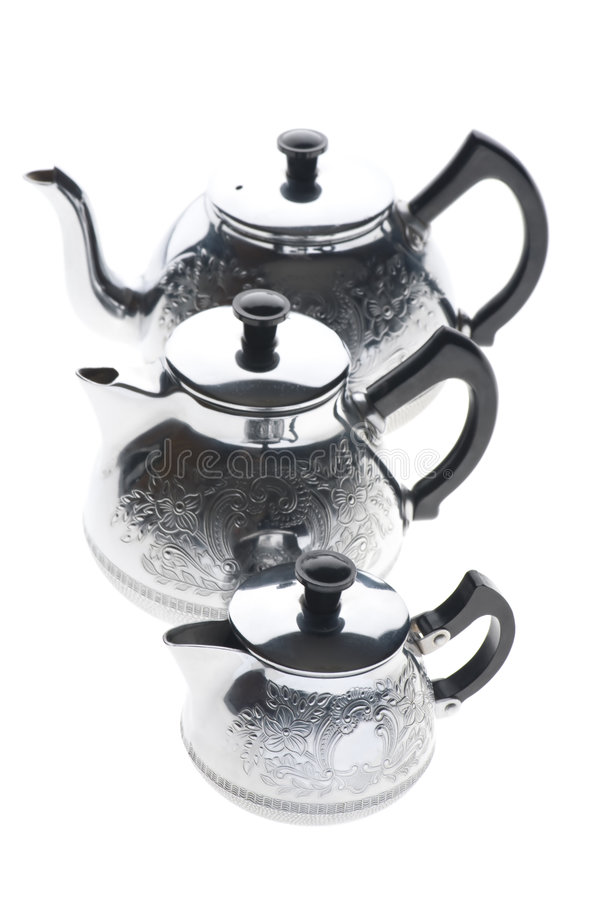 Three metal teapot on white royalty free stock photo