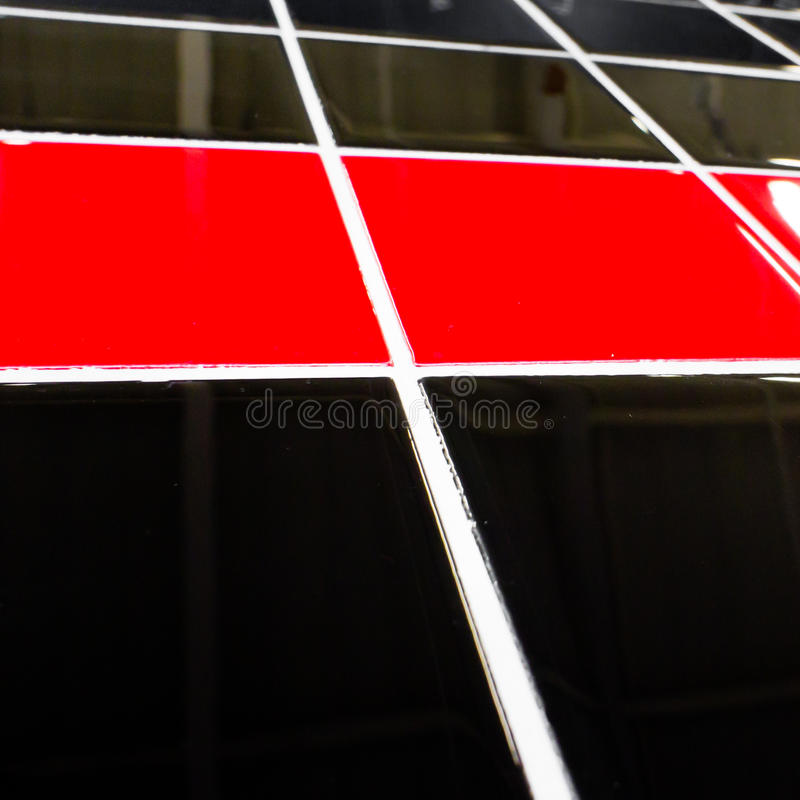 Tiles. Striking red and black modern ceramic tiles royalty free stock photography