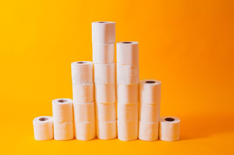 Toilet paper rolls info graphic, different heights columns. On the yellow stock photography