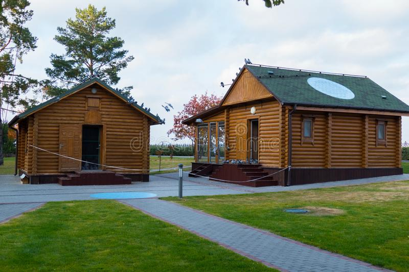 Two houses in the style of an old Russian log hut from wooden decks. For your design royalty free stock photography
