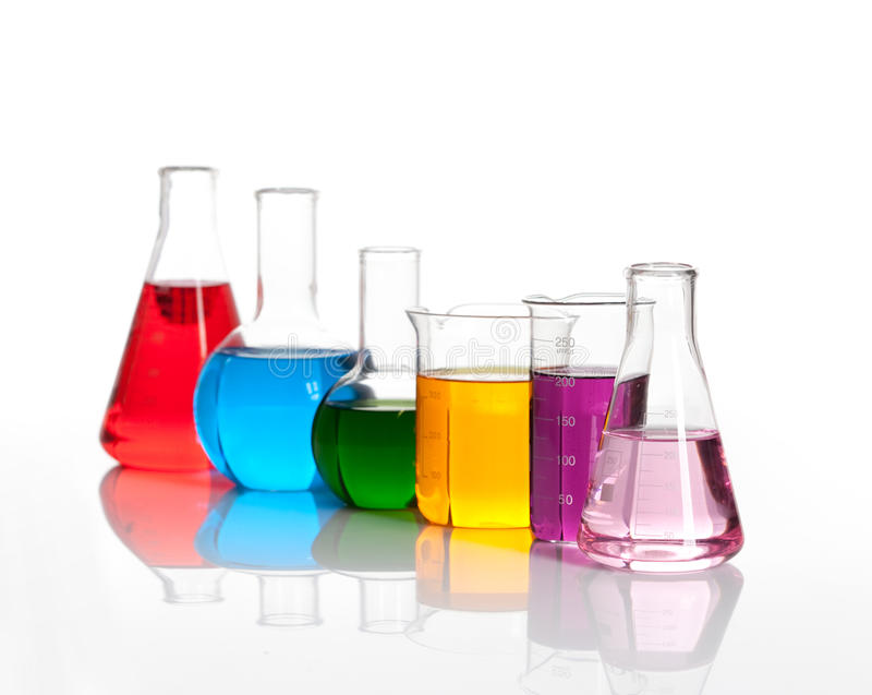 Various glass flasks with a colored liqiuds stock photography