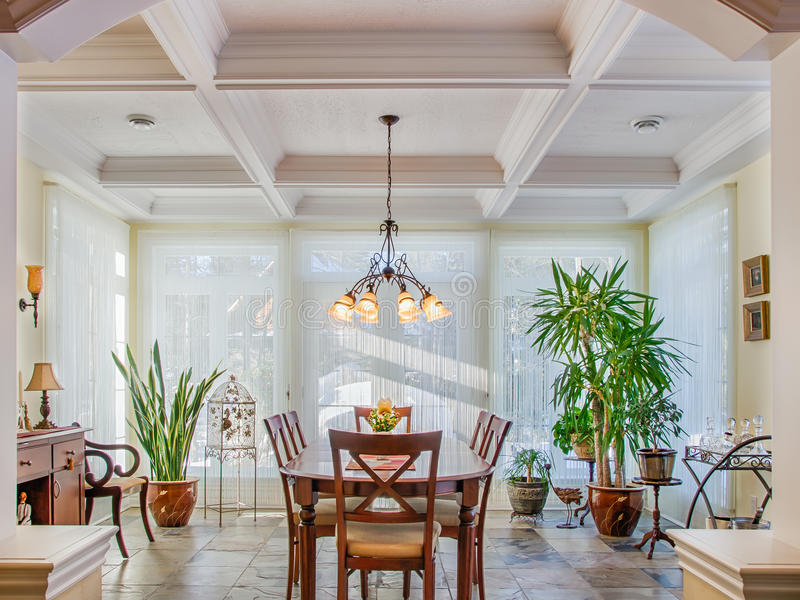 Vaulted ceilings in luxury yellow dining room stock photography