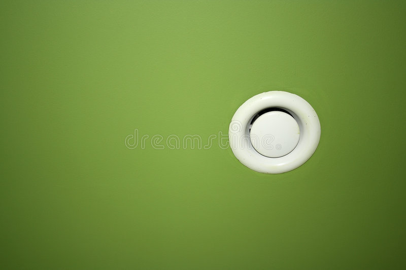 Ventilation. Built into a green ceiling, texture, background stock photo