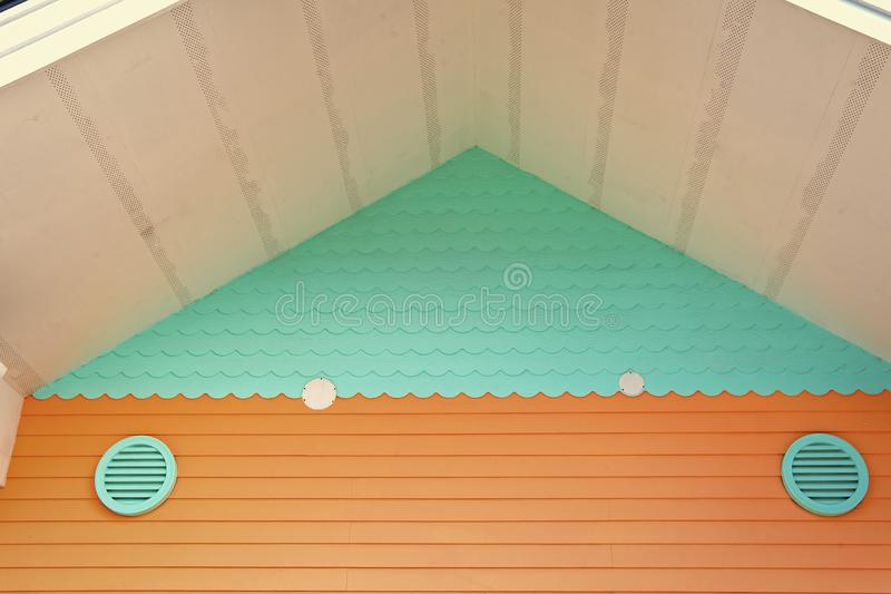 Ventilation on house. Whole house ventilation systems. Ways to ventilate your home. Air grate turquoise color on stock photography