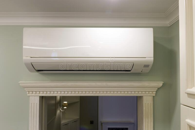 View of the air conditioning above the door in the room royalty free stock photo
