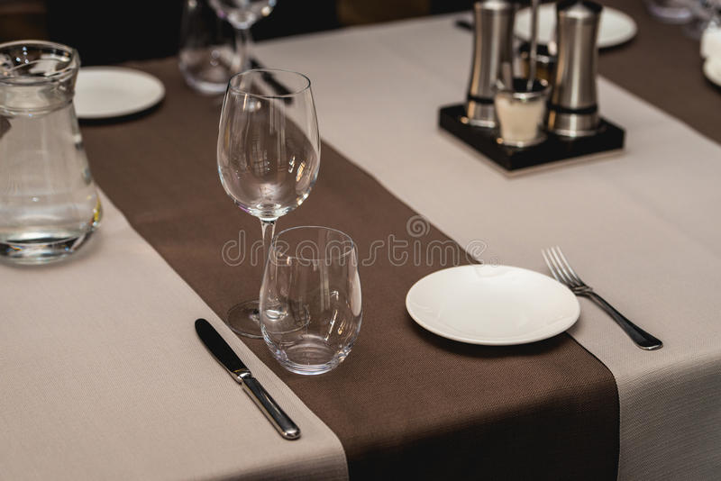 View of the served table in a restaurant. beige brown tones stock photos