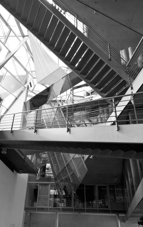 Modern stairs inside the building. View to the modern multistory stairs inside the building. Modern interior design stock images