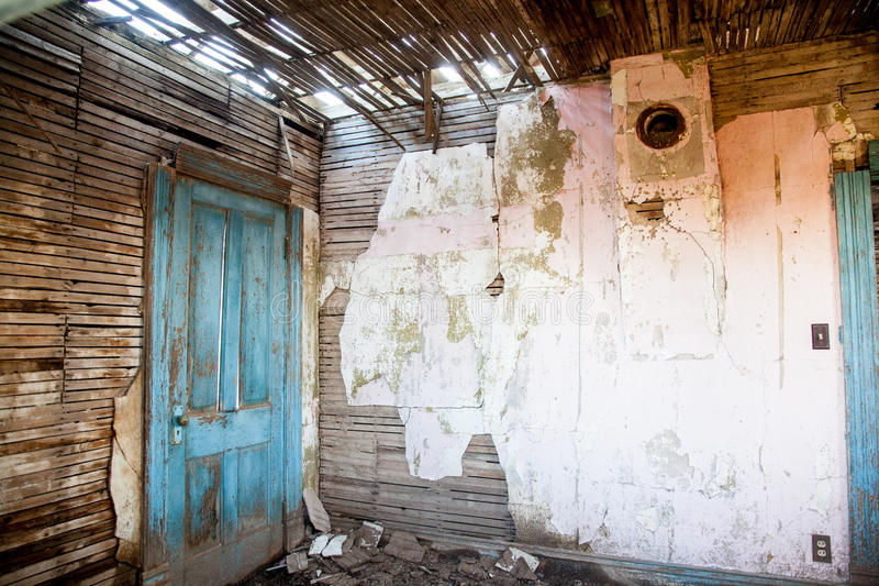 Vintage Old Room. Paint peels from an abandoned farm house room royalty free stock images