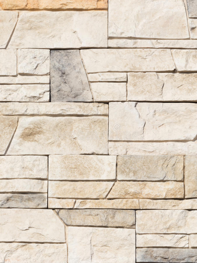 Wall made of artificial stone stock photography